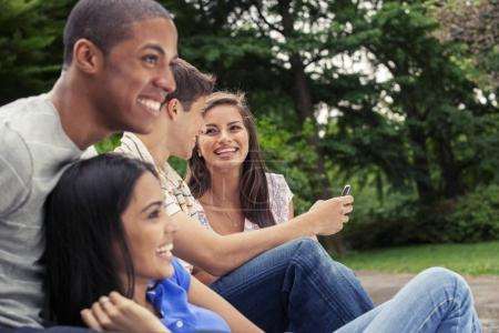 Teenage friends with mobile phone
