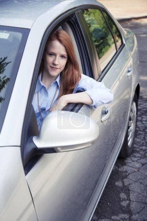 Teenager girl sitting in car