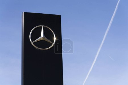 Mercedes-Benz car logo on dealership building on February 25, 2017 in Prague, Czech republic. Daimler does deal with Uber on autonomous vehicles fleet.