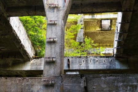Crumbling concrete constructions of former tin min...
