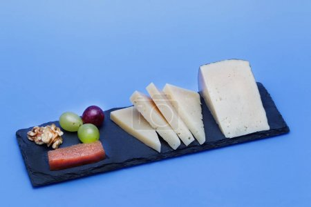 Wedges of cured Manchego cheese. Dairy product, de...