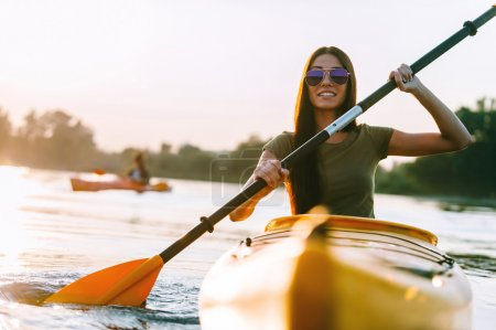 beautiful woman kayaking