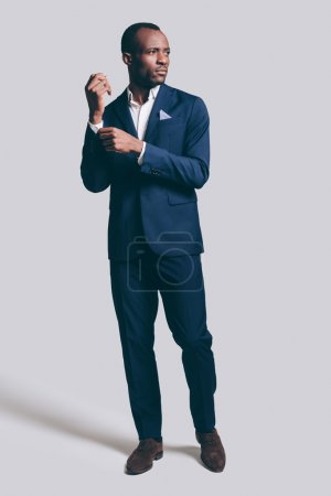 Photo for Confidence African man in suit posing in studio - Royalty Free Image