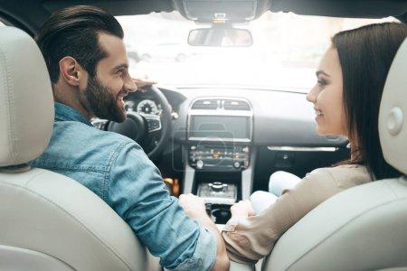 Beautiful couple driving car