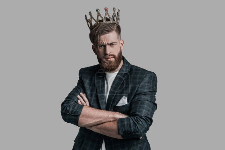 man with beard wearing crown