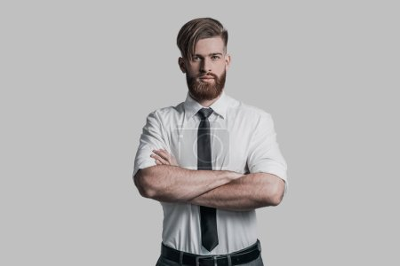 man with beard keeping arms crossed