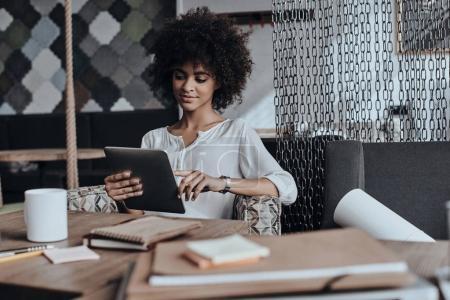 African woman browsing digital tablet