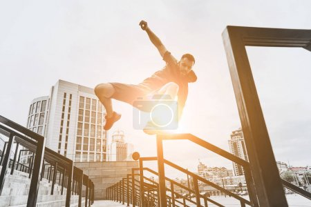active man jumping on stairs