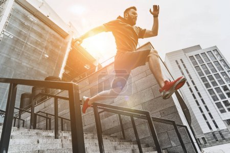 Photo for Full length shot of active man jumping on stairs, sport concept - Royalty Free Image