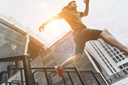 Photo for Active man jumping on stairs, sport concept - Royalty Free Image
