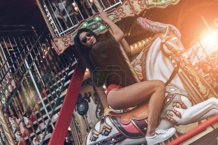 woman riding the merry go round