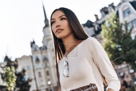 brunette woman in city