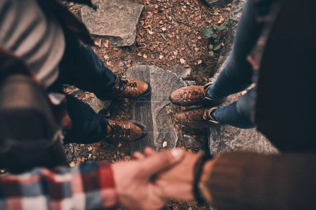 Photo for Partial view of couple holding hands in forest - Royalty Free Image