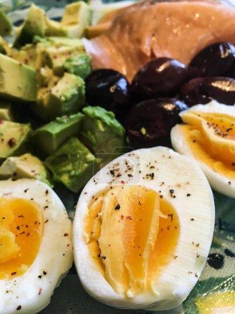 Photo for Mix fresh breakfast - boiled eggs, avocado, olives & smokes salmon - Royalty Free Image