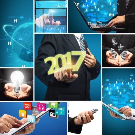 Businessman pushing 2017 on virtual screens