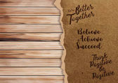 Ripped paper on texture of wood background with positive quotes