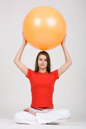 Photo pour Young woman with exercise ball 8 - image libre de droit