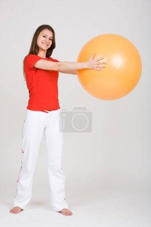 Photo pour Young woman with exercise ball 9 - image libre de droit