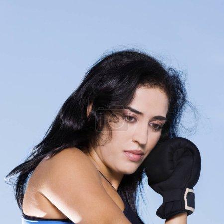 Photo pour Close-up of a mid-adult woman thinking - image libre de droit