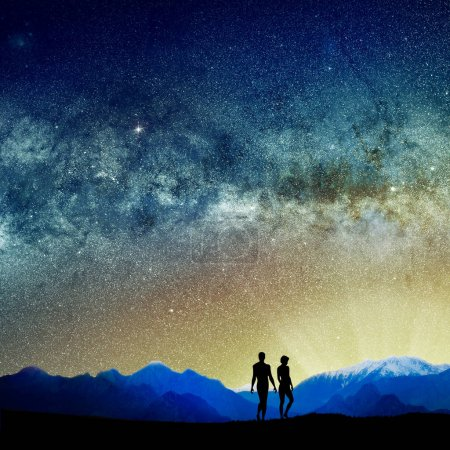Photo pour Conceptual image of silhouetted people and abstract universe lights. NASA galaxy images manipulated and used - image libre de droit