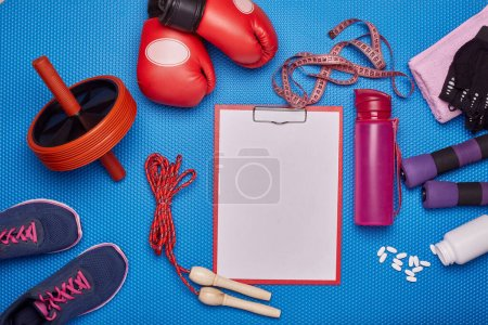 Sport accessories. Boxing gloves, dumbbells, rope,...