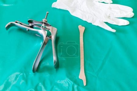 Photo for Colposcop, spatula and Medical gloves on a clean green blanket (Equipment vaginal speculum) for (Pap smear) gynecology inspect EXAMINATION Cervical cancer - Royalty Free Image