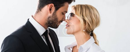 Photo for Panoramic shot of business couple looking at each other while flirting in office - Royalty Free Image