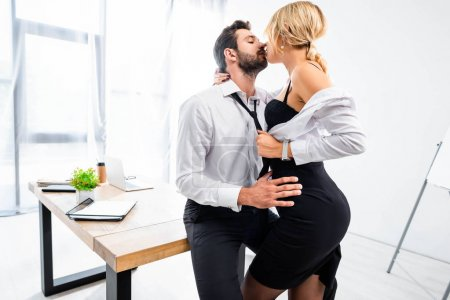 Photo for Sexy secretary tempting businessman at office table - Royalty Free Image