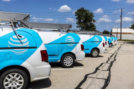 Indianapolis - Circa August 2017: AT&T Service vehicles. AT&T now offers Uverse, VoIP, Cell Phones and DirecTV XVII