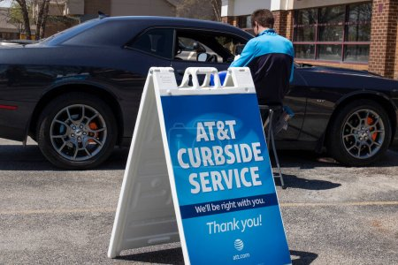West Lafayette - Circa May 2020: AT&T cell phone retail store. Amid new Social Distancing rules, AT&T is offering curbside service.
