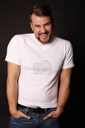 Photo for Fashion studio photo of handsome sexy man with muscular sportive body , wears casual clothes - Royalty Free Image