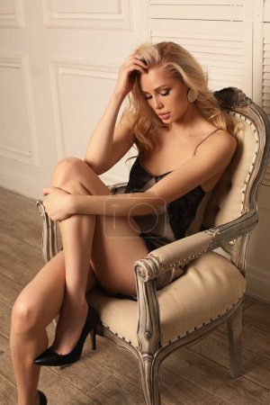 Photo for Fashion studio photo of beautiful sexy woman with blond hair in elegant lingerie dress - Royalty Free Image