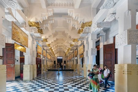 KANDY, SRI LANKA - MARCH 24: Pilgrims and tourists are inside of Temple of the Tooth (Sri Dalada Maligawa) in Kandy, Sri Lanka on March 24, 2014