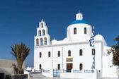 White blue orthodox church of Panagia Platsani, in the village of Oia. Santorini