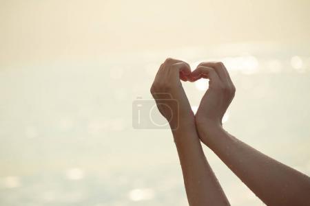 hands folded heart