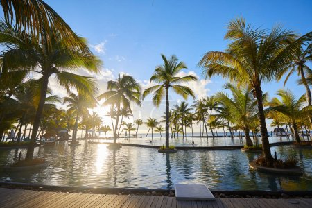 Photo for Luxury resort with poolside, tropical vacation. - Royalty Free Image