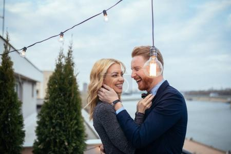 Photo for Couple enjoying a romantic dance together on balcony. - Royalty Free Image