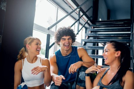 Photo for Shot of three athlete friends laughing at the gym. - Royalty Free Image