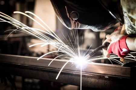 Photo for Welding steel with sparks using mig mag welder - Royalty Free Image
