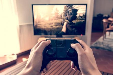 Photo for Man Playing video game on the console. Blank tv screen mockup template - Royalty Free Image