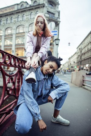cute young couple of teenagers girlfriends having fun, traveling europe, modern fashion citylife, lifestyle people concept