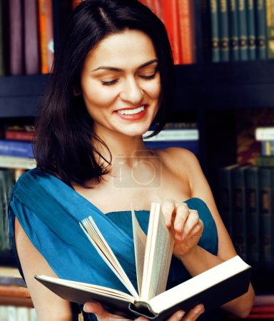 Portrait of beauty young brunette woman reading book in library smiling, muslim girl in education, lifestyle people concept
