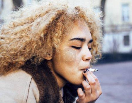 young girl outside smoking