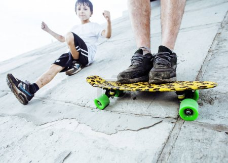 father with his son and skateboard