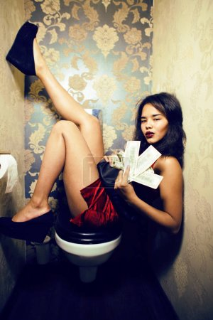 Photo for Pretty young african american woman in luxury restroom with money, like prostitute, dirty cash concept - Royalty Free Image