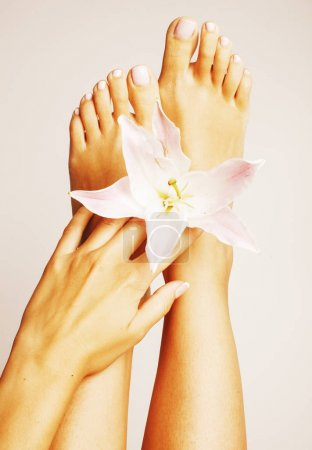 Hands and feet with flower lily