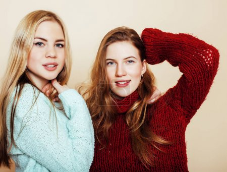 Two young girlfriends in winter sweaters