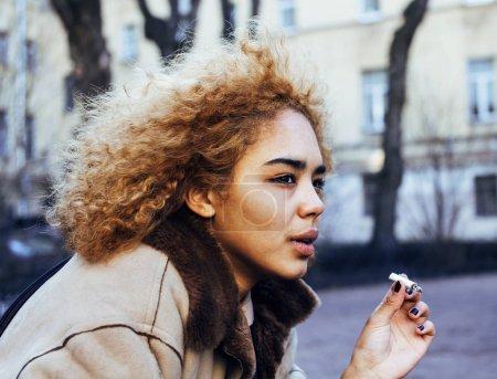 girl outside smoking cigarette