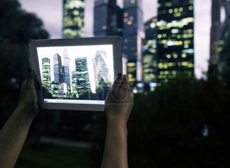 Female hands holding tablet