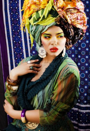 bright woman with many shawls on head